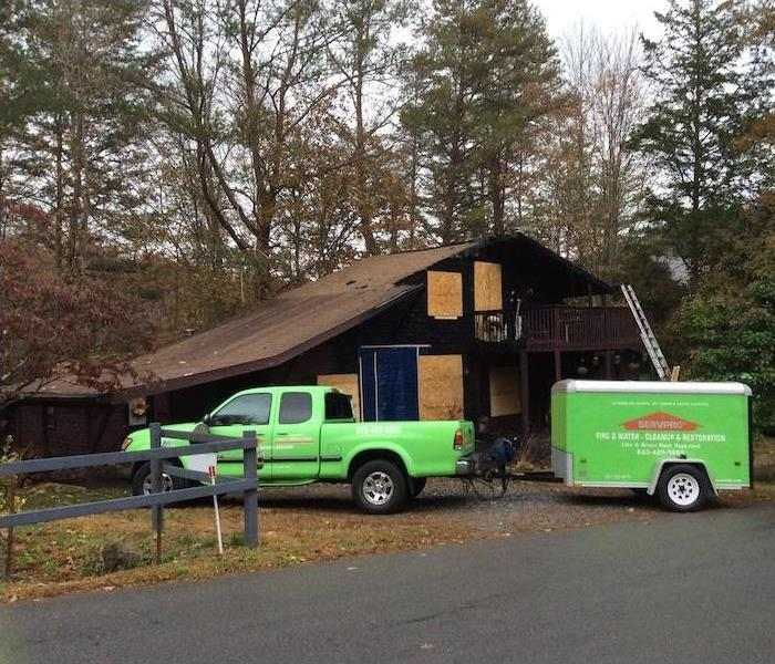 SERVPRO vehicle and trailer outside job site.