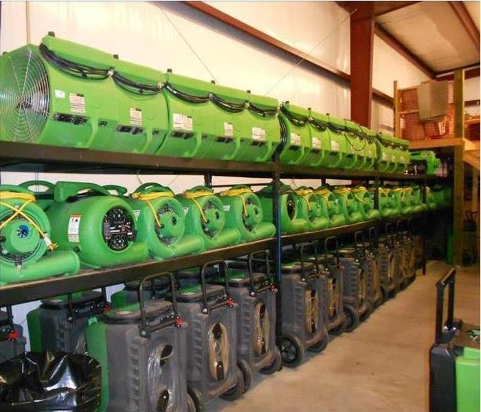 rows of our equipment on shelves in our warehouse ready for any size job